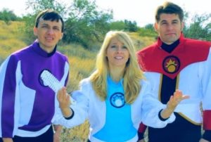 "Doctor Rena (center) attempts to communicate with a ""Great Space Crystal"" while First Officer Powell and Captain Sunstrike look on"