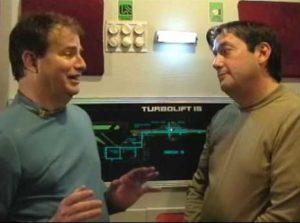First Officer Brian Reigert and Lieutenant Commander Robert Shelton share an uncomfortable ride in a turbolift